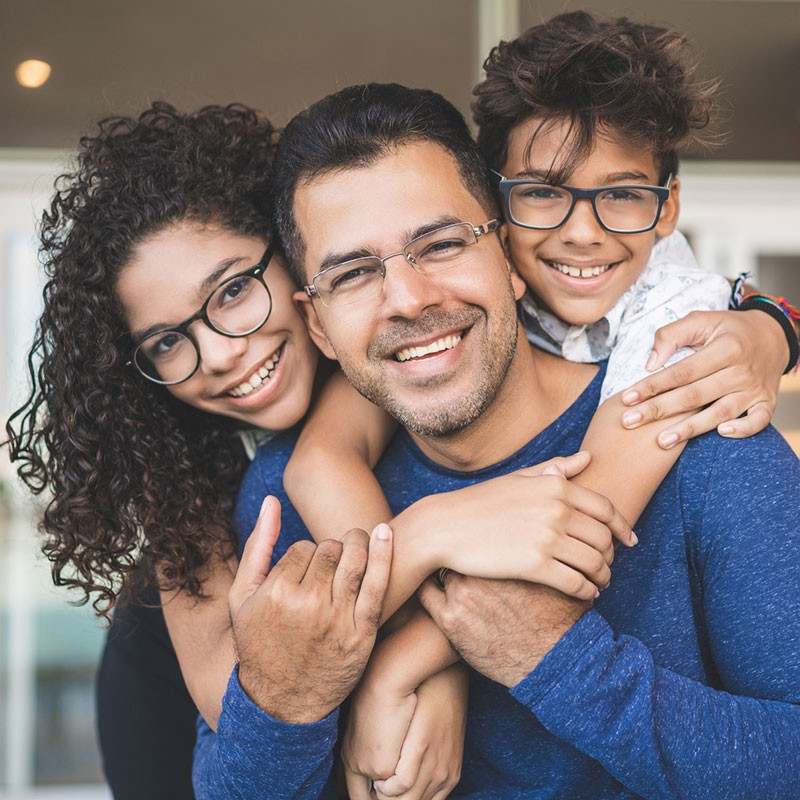 Family picture of man with daughter and son, each with glasses